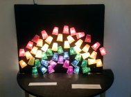 A rainbow light sculpture made during a community center art project.