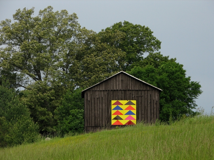 This colorful barn quilt with the flying geese pattern can be found in Trigg County