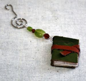 For the author or reader, take a look at these Memory Book Ornaments by ReImagined by Luna. The mini-books can be used for writing little notes or memories. They are made from reclaimed leather and recycled, acid-free paper and are available in many colors.